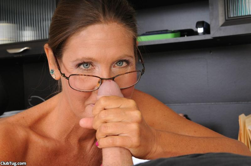 Horny mature woman jerks off her stepson in her office until he